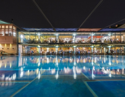restaurant at night across pool